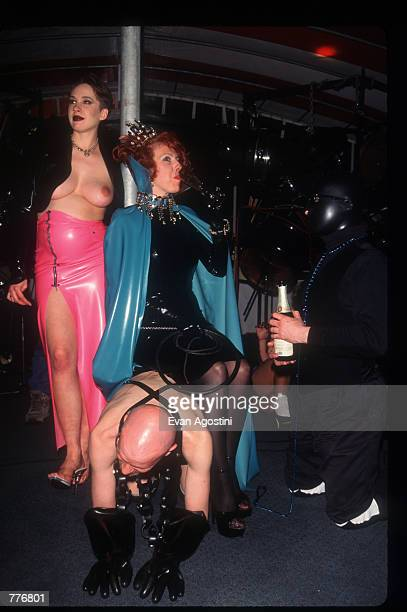 Mistress Carrie sits on the back of a slave at the third Black Blue Ball fetish event May 3 1996 in New York City The Black Blue Ball featured a...