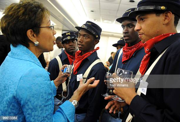 Mistress of Ceremonies Andrea Roane of WUSA9 talks with members of the Vision Quest Buffalo Soldiers from Pennsylvania who were on hand for the 10th...