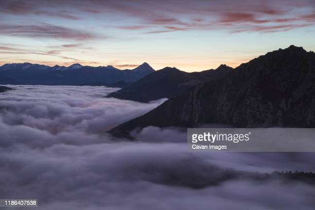 mists at sunrise from the top of some mountains - leon boden stock-fotos und bilder
