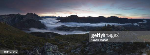 mists at sunrise from the top of some mountains - león province spain stock pictures, royalty-free photos & images