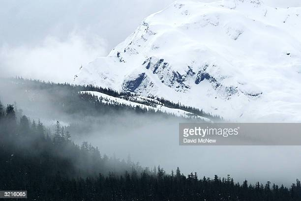 Mists move over mountains rising from Prince Willam Sound on April 4 2004 near Valdez Alaska Fifteen years after the Exxon Valdez supertanker split...