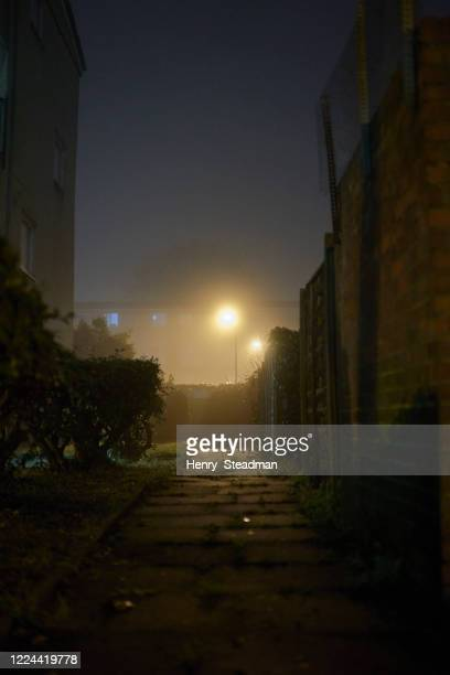 misty alley in urban night scene - enfield london stock pictures, royalty-free photos & images