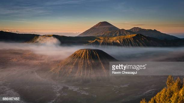 misty bromo at sunrise - mt bromo stock photos and pictures