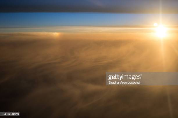 Misty clouds under morning sun in the sky at sunrise