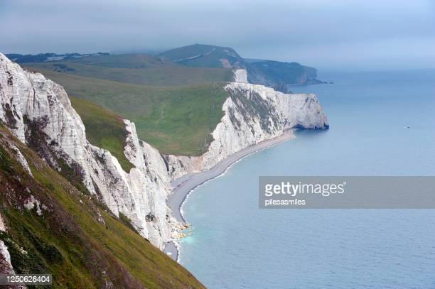 misty coastal vista, osmington mills, ringstead bay, jurassic coast, dorset, england - weymouth dorset stock pictures, royalty-free photos & images