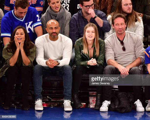 Misty Copeland Olu Evans Madelaine Duchovny and David Duchnovy attend Golden State Warriors Vs New York Knicks game at Madison Square Garden on March...