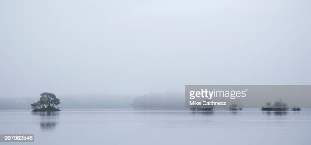 misty derwentwater islands - mike caithness stock pictures, royalty-free photos & images