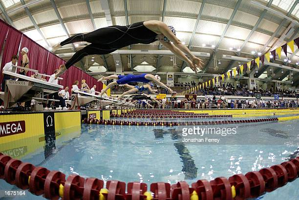 Misty Hymen dives off the blocks at the start of the 100m Butterfly during the US Open Swimming Championships on December 6 2002 at the University of...