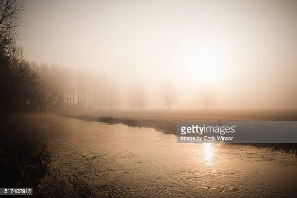 misty marshland sunrise - east anglia stock pictures, royalty-free photos & images