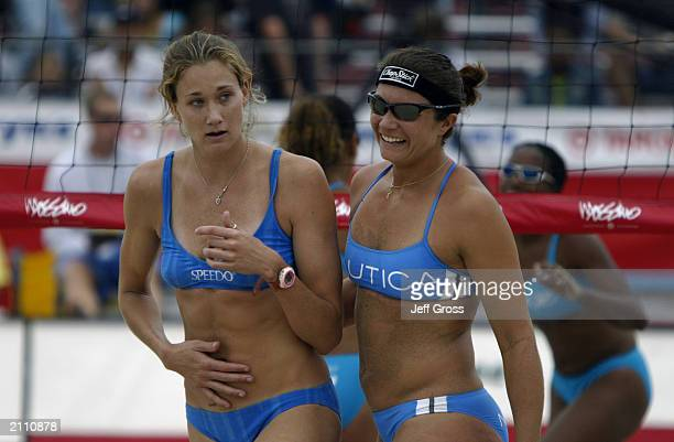 Misty May and her partner Kerri Walsh celebrate a point during their match against Jenny Johnson Jordan and Annett Davis in the AVP Nissan Series...