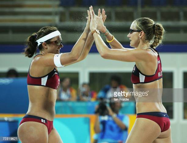 Misty May and Kerri Walsh of the United States celebrate in the women's preliminary match on August 17 2004 during the Athens 2004 Summer Olympic...
