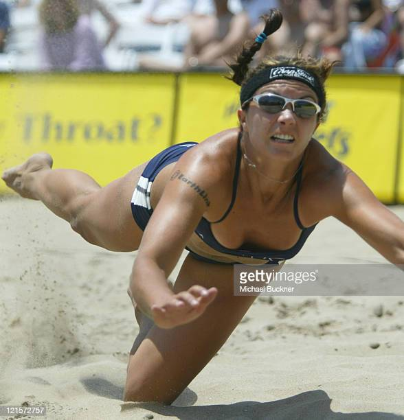 Misty May dives for the ball during the semifinal match against Annett Davis and Jenny Johnson Jordan Riding an 88 game winning streak May and her...
