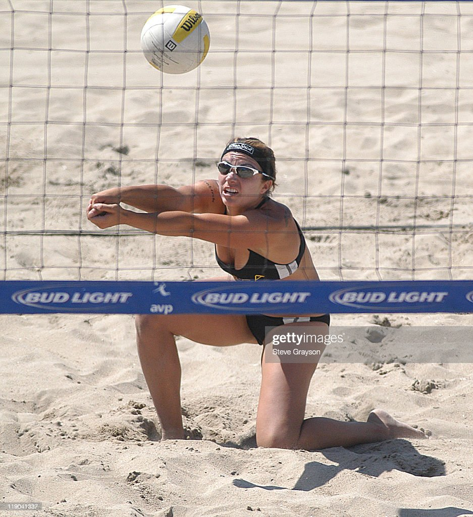 Misty May hits a dig in the women's final of the 2004 AVP Nissan Series Hungting Beach Open at the Huntington Beach Pier, May 30, 2004.