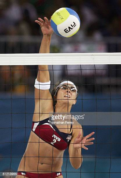 Misty May of United States spikes the ball to Adriana Behar and Bede Shelda of Brazil in the women's gold medal match on August 24 2004 during the...