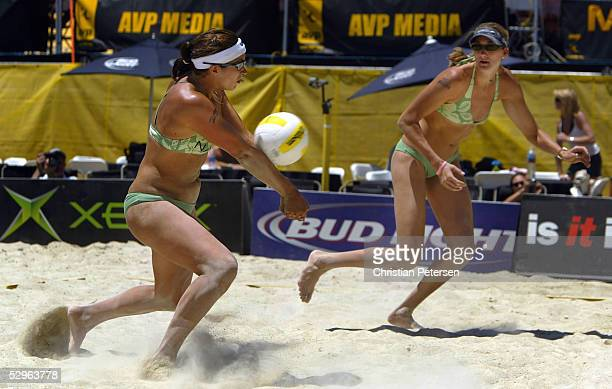 Misty May passes the ball to teammate Kerri Walsh in the quarterfinal match up against Samirames Marlins and Tatiana Minello during the AVP 2005...