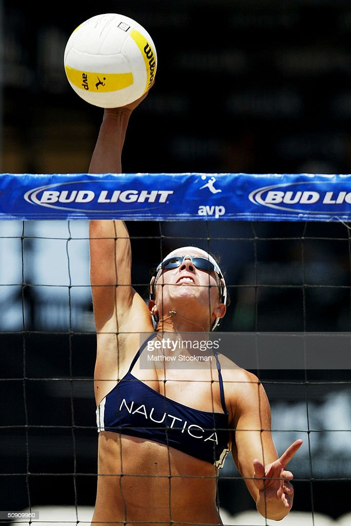 Misty May Spikes The Ball Against Heather Lowe And Jenny Pavley During The Bud  Light Huntington