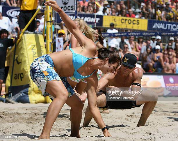 Misty MayTreanor and Casey Jennings dance on the court during a break from the AVP Hermosa Beach Open final on June 8 2008 at the Pier in Hermosa...