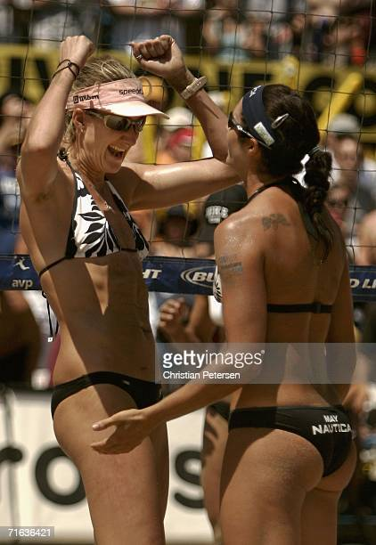 Misty MayTreanor and Kerri Walsh celebrate after winning the AVP Manhattan Beach Open final match on August 12 2006 in Manhattan Beach California...