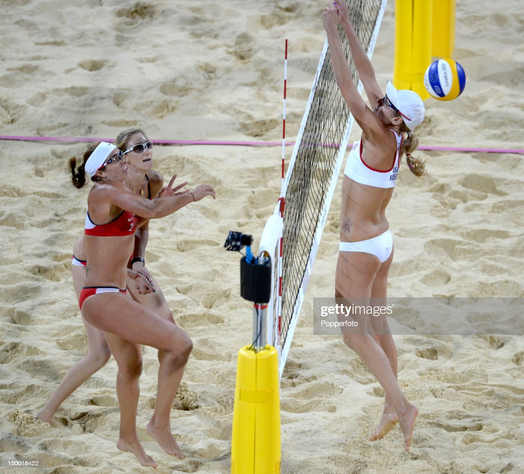 Misty May-Treanor and Kerri Walsh Jennings (L) of the United States return the ball past Jennifer Kessy of the United Staes during the Gold Medal Women's Beach Volleyball match on Day 12 of the London 2012 Olympic Games at the Horse Guard's Parade on August 8, 2012 in London, England.