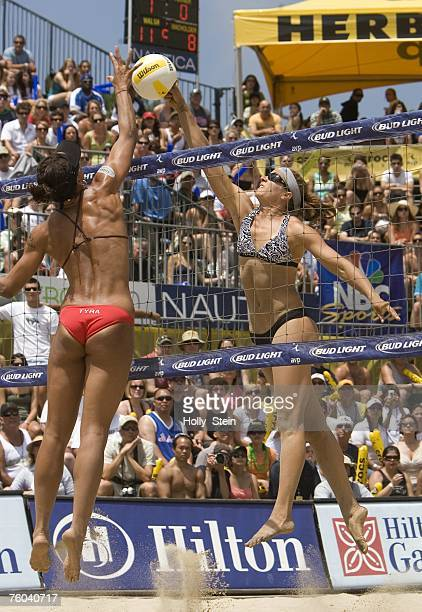 Misty MayTreanor and Tyra Turner joust at the net during the women's finals in the AVP Long Beach Open at Marina Green Park on July 21 2007 in Long...