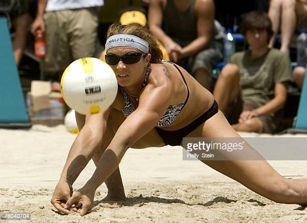 Misty MayTreanor digs the ball during the women's finals against Tyra Turner and Rachel Wacholder in the AVP Long Beach Open at Marina Green Park on...
