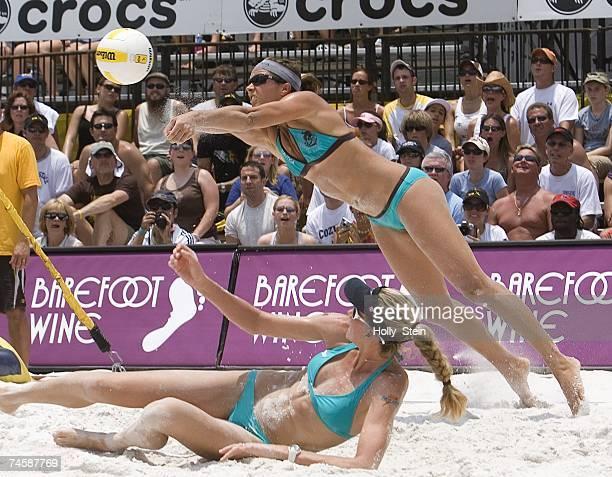 Misty MayTreanor digs the ball over partner Kerri Walsh during the women's semifinals against Annett Davis and Jenny Johnson Jordan in the AVP...