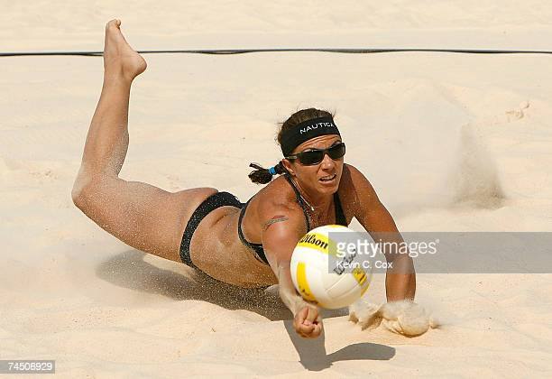 Misty MayTreanor dives in the sand to save a ball in the women's finals match against Tyra Turner and Rachel Wacholder during the AVP Crocs Tour...