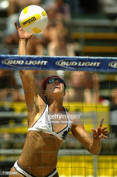 Misty May-Treanor hits the ball against Tyra Turner and Makare Wilson in the AVP Manhattan Beach Open match on August 11, 2006 in Manhattan Beach,...