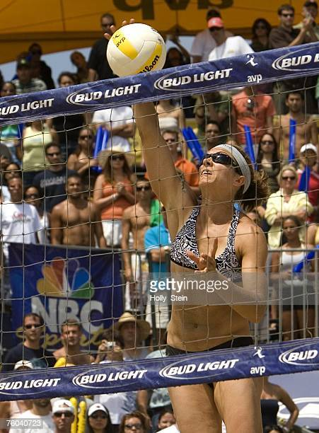 Misty MayTreanor hits the ball during the women's finals against Tyra Turner and Rachel Wacholder in the AVP Long Beach Open at Marina Green Park on...