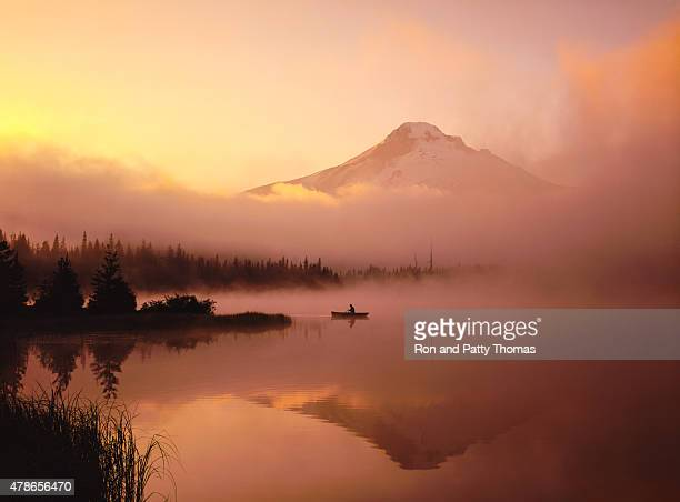 Misty morning, canoe, with the reflection of  Mt. Hood, OR