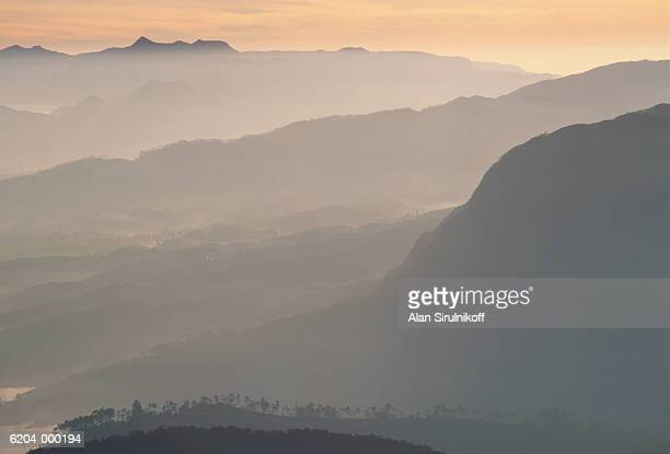 misty mountains - sirulnikoff stock photos and pictures