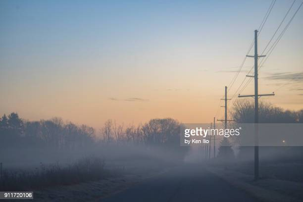 misty rural highway - indiana stock pictures, royalty-free photos & images