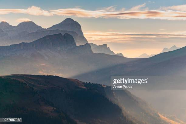 Misty sunrise at Pass Pordoi. Dolomites mountains, Italia.
