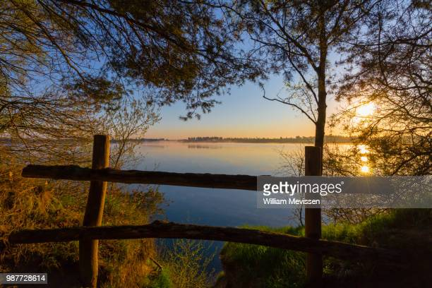 misty sunrise 'fence' - william mevissen stock pictures, royalty-free photos & images