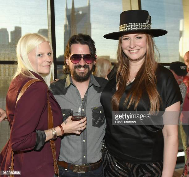 Misty Swain Shooter Jennings and Hilary Williams attend the CMHOF Outlaws and Armadillos VIP Opening Reception on May 24 2018 in Nashville Tennessee