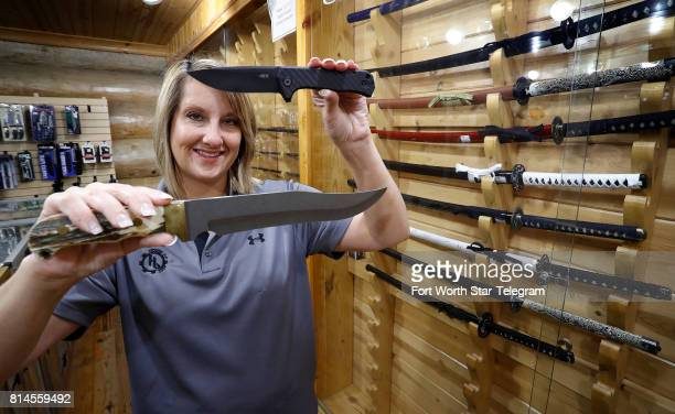 Misty Thomas holds a legal everyday carry folding knife and one of the store's larger Bowie knives The staff at House of Blades in west Fort Worth...