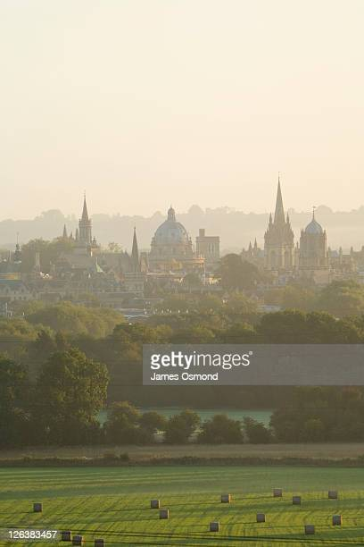 a misty view over the fields toward the oxford skyline at sunrise. - oxford university stock pictures, royalty-free photos & images