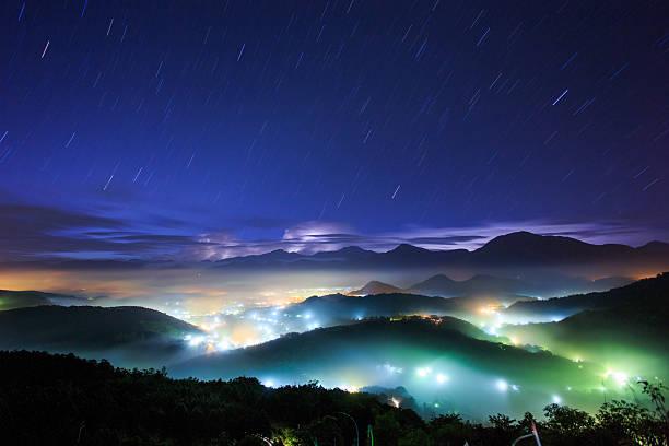 Misty village in sky of stars