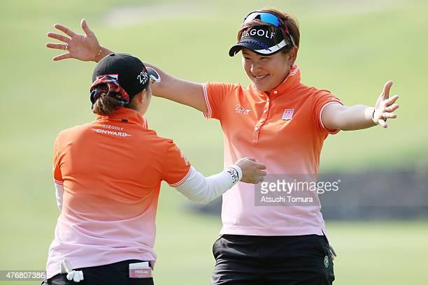 Misuzu Narita and Erika Kikuchi of Japan reacts after finishing the second round of the Suntory Ladies Open at the Rokko Kokusai Golf Club on June 12...