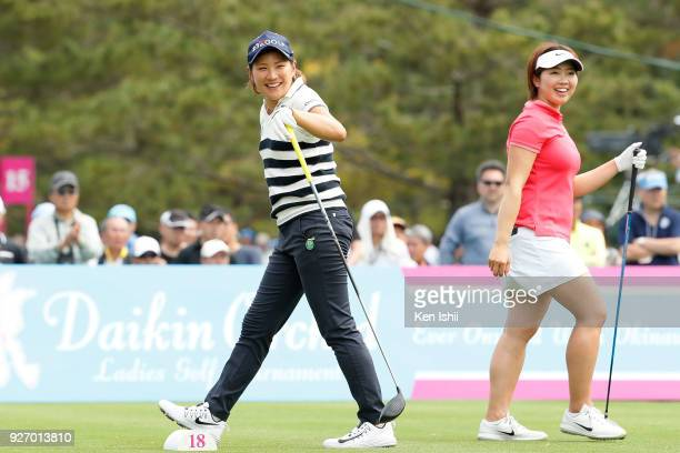 Misuzu Narita and Rumi Yoshiba of Japan smile on the 18th hole during the final round of the Daikin Orchid Ladies at Ryukyu Golf Club on March 4 2018...