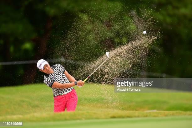 Misuzu Narita of Japan hits out from a bunker on the 8th hole during the first round of the Stanley Ladies at Tomei Country Club on October 11, 2019...