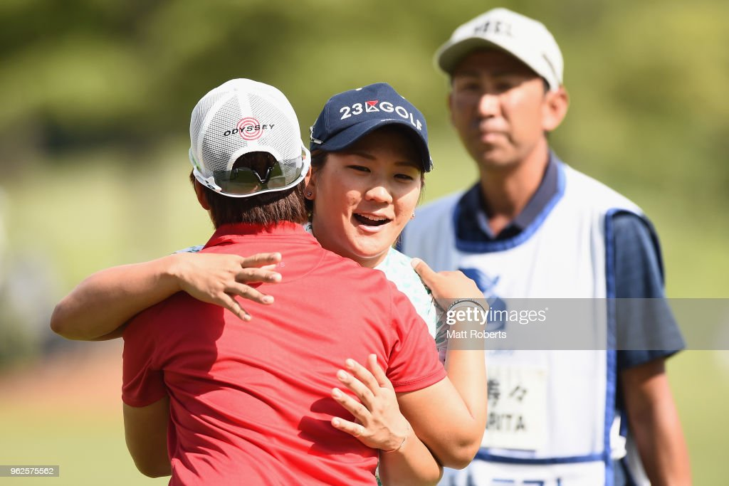 Misuzu Narita of Japan hugs Hee-Kyung Bae of South Korea on the 18th green during the second round of the Resorttust Ladies at Kansai Golf Club on May 26, 2018 in Miki, Hyogo, Japan.