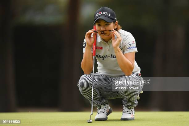 Misuzu Narita of Japan lines up her putt on the 8th hole during the first round of the World Ladies Championship Salonpas Cup at Ibaraki Golf Course...