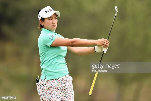 Misuzu Narita of Japan looks at her golf club after her approach shot on the 18th hole during the final round of the Resorttust Ladies at Kansai Golf...