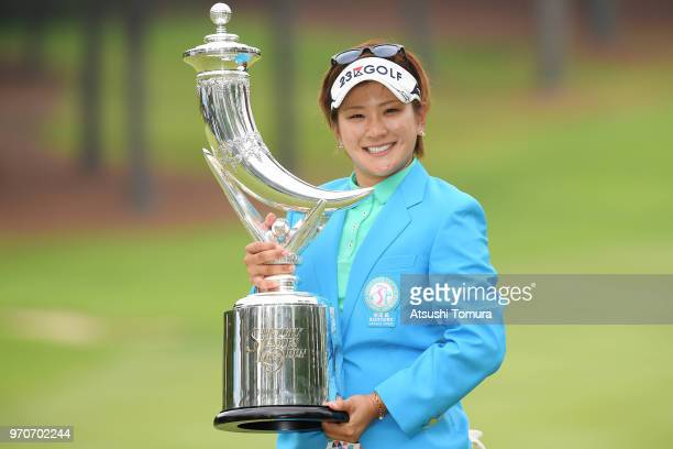 Misuzu Narita of Japan poses with the trophy after winning the Suntory Ladies Open Golf Tournament at the Rokko Kokusai Golf Club on June 10 2018 in...
