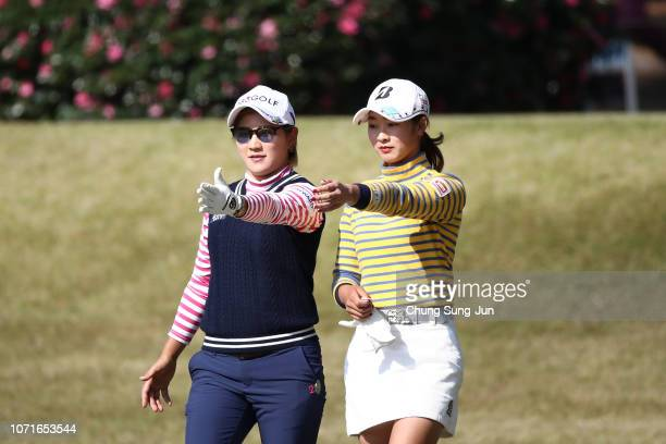 Misuzu Narita of Japan talks with Rei Matsuda of Japan on the 15th hole during the third round of the LPGA Tour Championship Ricoh Cup at Miyazaki...