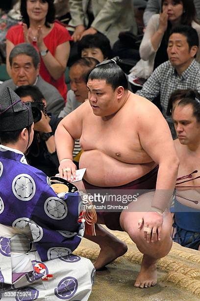 Mitakeumi reacts after winning against Daishomaru during day fifteen of the Grand Sumo Summer Tournament at the Ryogoku Kokugikan on May 22 2016 in...