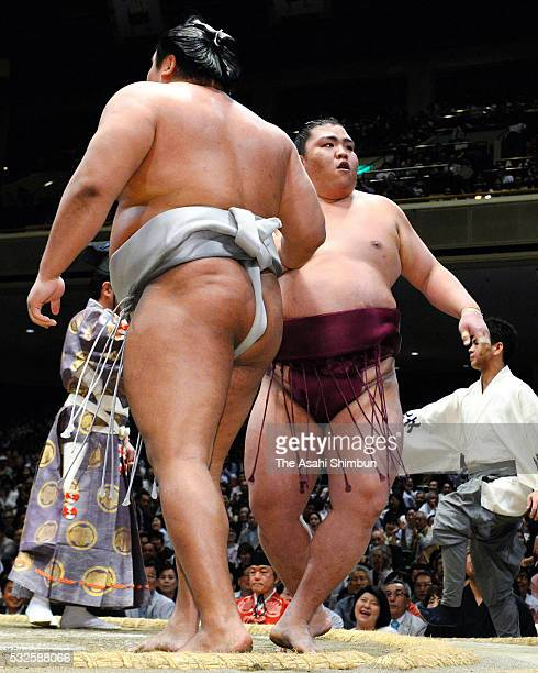 Mitakeumi reacts after winning against Mongolian wrestler Takanoiwa during day eleven of the Grand Sumo Summer Tournament at the Ryogoku Kokugikan on...