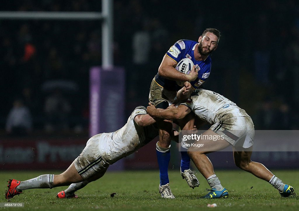 Mitch Achurch of Leeds Rhinos is tackled during the First Utility Super League match between Leeds Rhinos and Widnes Vikings at Headingley Carnegie Stadium on February 13, 2015 in Leeds, England.