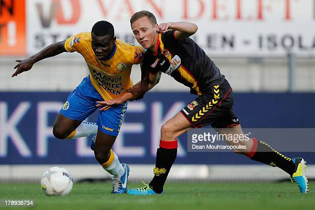 Mitch Apau of RKC is tackled by Job van der Linden of Go Ahead during the Eredivisie match between RKC Waalwijk and Go Ahead Eagles at the...